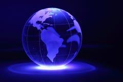 玻璃地球由光从下面照亮 免版税图库摄影