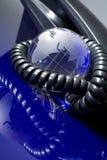 玻璃地球电话 免版税库存图片