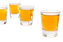 玻璃射击威士忌酒 免版税库存照片