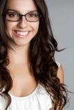 玻璃微笑的妇女 免版税库存图片