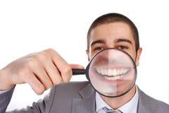 玻璃扩大化的人 免版税库存照片