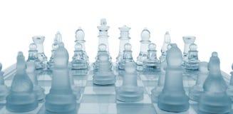 玻璃棋。 第一个移动。 免版税库存图片