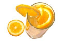 玻璃水多的桔子 图库摄影
