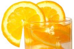 玻璃水多的桔子 免版税图库摄影