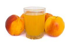 玻璃汁液桃子 图库摄影