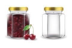 玻璃瓶子用樱桃果酱和倒空 免版税库存图片