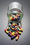 玻璃瓶子药片 免版税库存图片