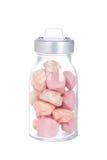 玻璃瓶子蛋白软糖粉红色 库存图片