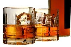 玻璃瓶查出威士忌酒 图库摄影