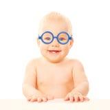 玻璃的愉快的微笑的婴孩。 免版税库存照片