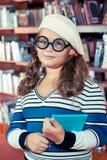 玻璃的智能女孩 免版税库存图片