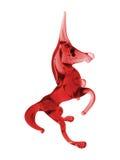 玻璃红色独角兽 库存照片