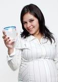 玻璃纵向怀孕的水妇女 库存照片