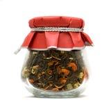 玻璃草本查出的瓶子茶 免版税库存图片