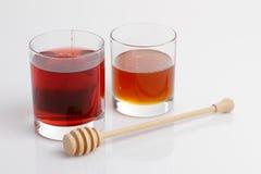 玻璃蜂蜜棍子 免版税库存图片