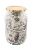 玻璃银行的钞票 免版税库存图片