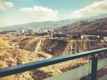 玻璃阳台在铁建筑,从阳台的看法在第比利斯,乔治亚 免版税库存照片