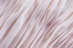 珊瑚在桌上的织品说谎的折叠背景  免版税库存图片
