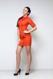 珊瑚礼服性感的妇女 免版税库存图片