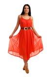 珊瑚礼服的少妇 免版税库存照片