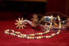 珍珠和踢马刺 免版税库存照片