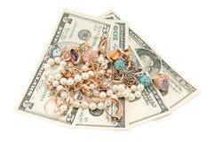珠宝和货币 免版税库存图片