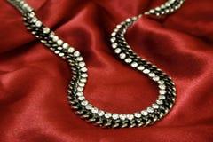 珠宝红色丝绸 免版税图库摄影