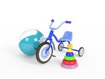 球、三轮车和金字塔 免版税库存照片