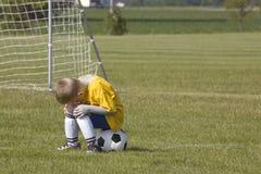 球员哀伤的足球 库存图片