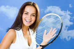 球员微笑的网球 免版税库存图片
