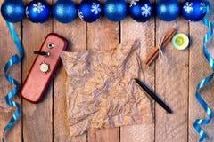球圣诞节背景和丝带,羊皮纸wi板料  库存图片