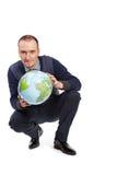 球地球半人位置蹲 免版税库存照片