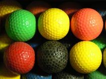 球微型狂妄剧的高尔夫球 图库摄影