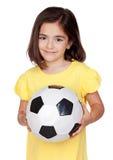 球深色的女孩一点足球 库存照片