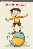 球的一个男孩 免版税库存照片