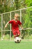 球童足球 免版税图库摄影