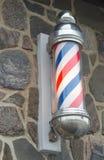 理发店杆红色蓝色和白色小条标志 免版税图库摄影