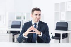 年轻经理和skype 库存图片