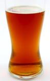 琥珀色的啤酒结算玻璃 免版税图库摄影