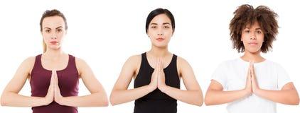 瑜伽凝思概念,在白色背景在namaste姿态的三只妇女手隔绝的,白种人亚裔美国黑人的妇女 免版税库存照片
