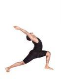 瑜伽在白色的战士姿势 免版税库存照片