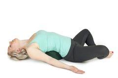 瑜伽妇女绿色position_126 免版税库存照片