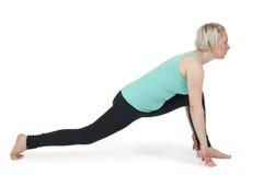 瑜伽妇女绿色position_191 免版税图库摄影