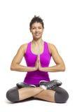 瑜伽姿势佩带的体育运动成套装备的少妇 库存图片