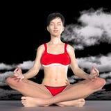 瑜伽姿势凝思的妇女 免版税库存照片