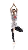 瑜伽姿势的妇女,与图画骨骼 免版税图库摄影