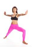 瑜伽姿势的-战士位置俏丽的妇女。 免版税库存图片