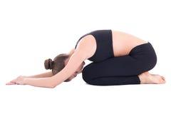 瑜伽姿势的年轻美丽的妇女 图库摄影