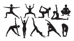 瑜伽摆在白色背景的剪影 免版税库存照片