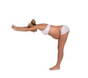 瑜伽摆在的孕妇 免版税库存照片